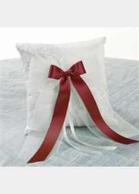 """Satin pillow with asymmetrical Chantilly lace, and a full organza bow is topped with your choice of colored ribbon to coordinate with your wedding. Pillow is 8"""" square."""