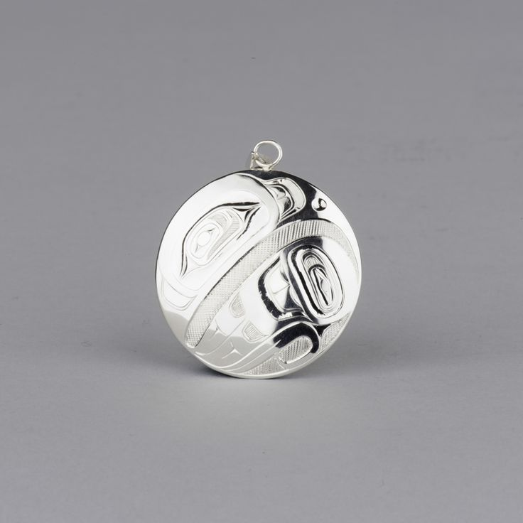 Eagle pendant in sterling silver by Haida artist Ernest Swanson