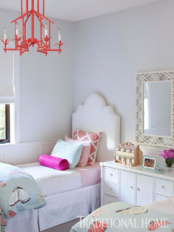 A colorful chandelier from Shades of Light sets a playful tone in this kids' room. - Photo: Jessica Glynn / Design: Maggie Cruz