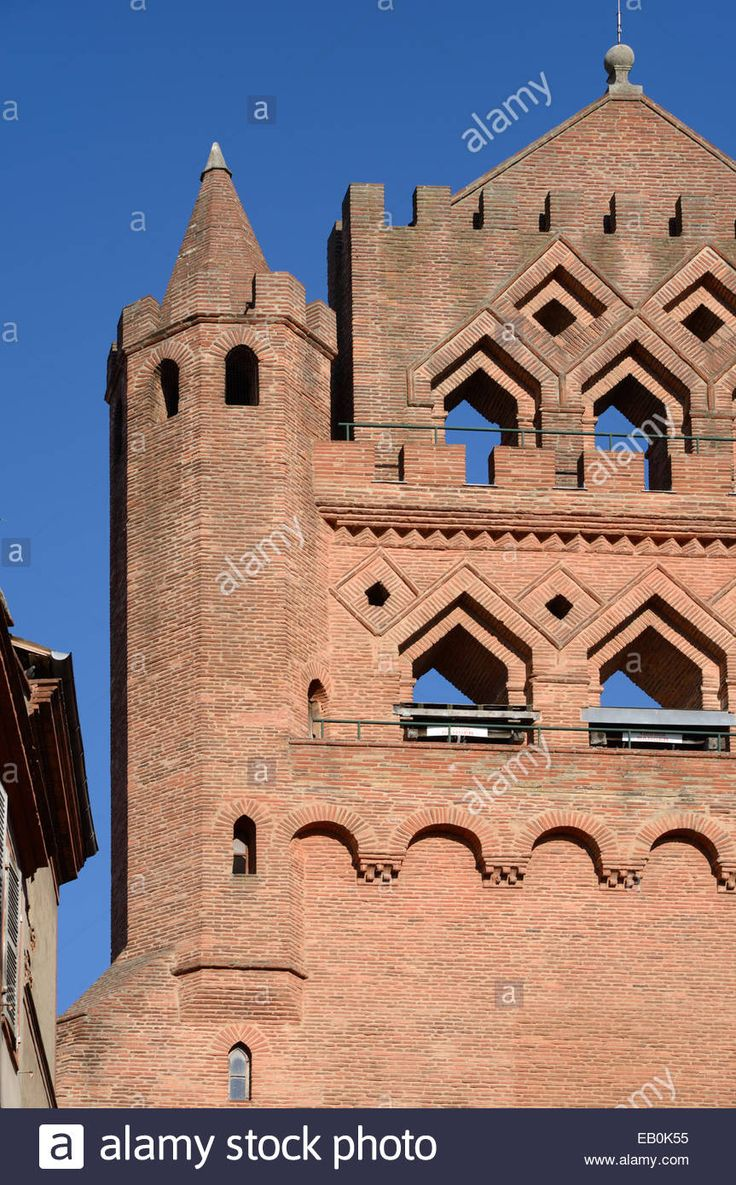 Ornate Red Brick Detail On The Facade Of The Gothic Notre Dame De Stock Photo…