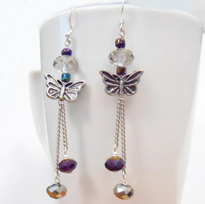 Butterfly Charm with swarovski crystals and a dangle chain on Handmade Artists' Shop.  ($8.75; plated, cute;  I have these components already!)
