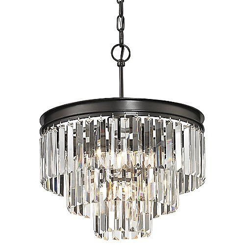 The Elk Lighting Palacial Chandelier presents timeless elegance with tiers of cascading prismatic crystals hanging from a round frame. The thick triangular shape of the crystals provide a maximum refracting and reflection of light, enhancing the piece