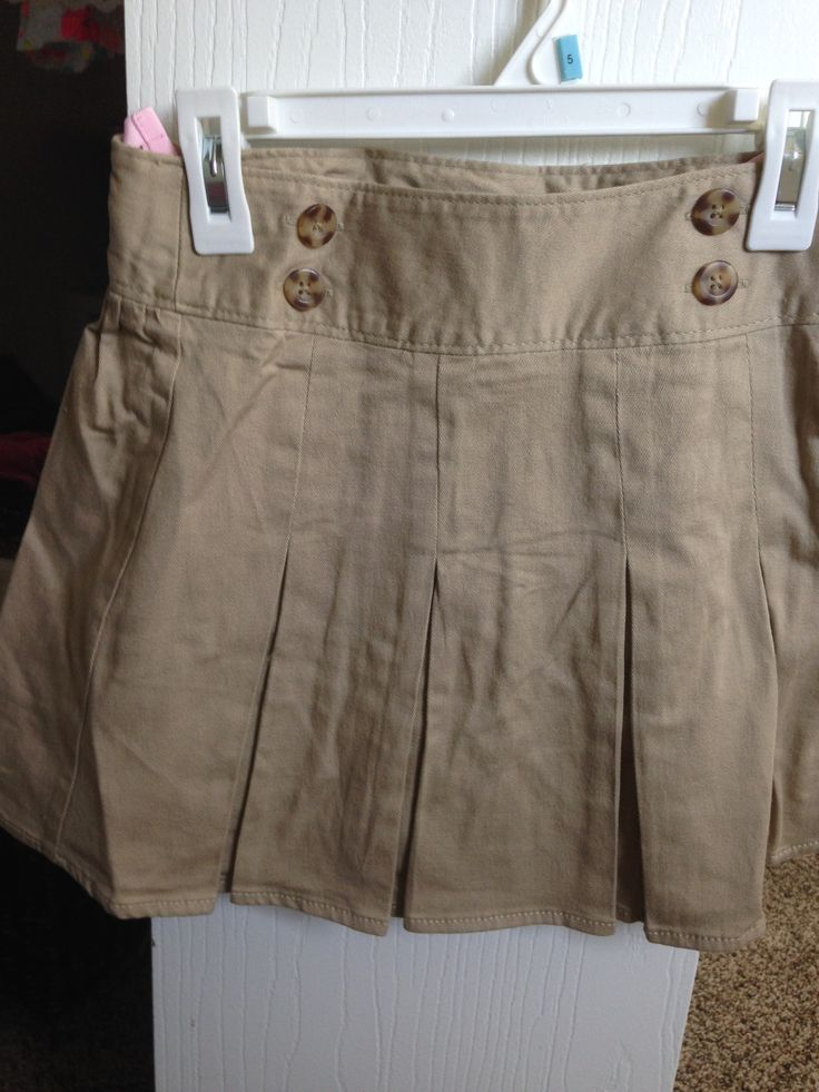 Old Navy - Khaki Skort (Bought 2 Pack) A. Old Navy - $10 each B. None C. My daughter loves to wear skirts and it's always a bonus when they have shorts built-in, so she can still play in them! Very functional!