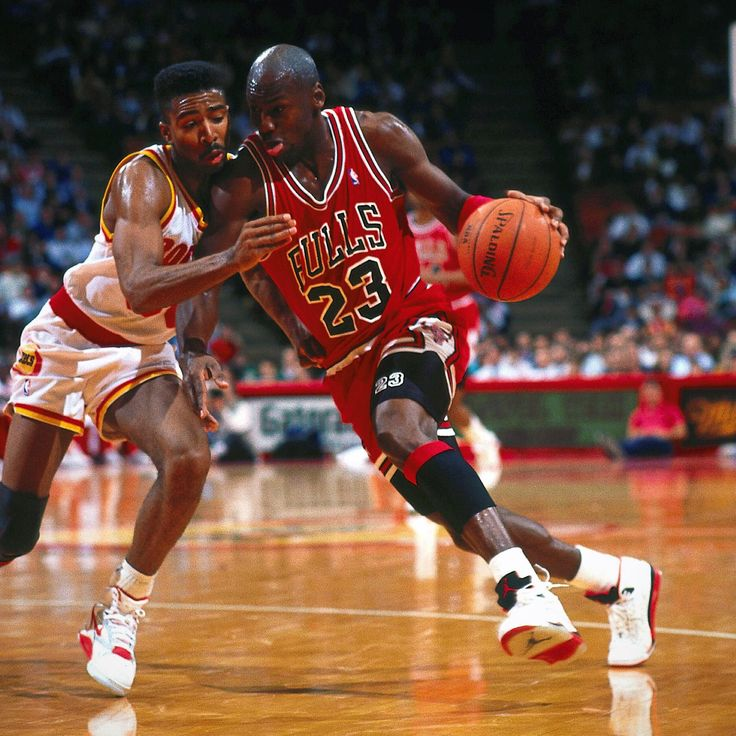 Kenny Smith tries to guard former Tar Heel teammate and shooting god Michael Jordan.
