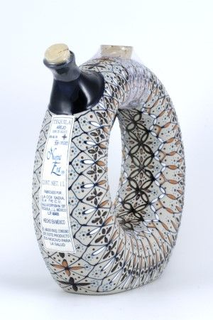 Nueva Era Anejo Tequila   hand-made ceramic bottle and individually painted http://distilus.com/beverages/tequila/tequila-nueva-era-anejo