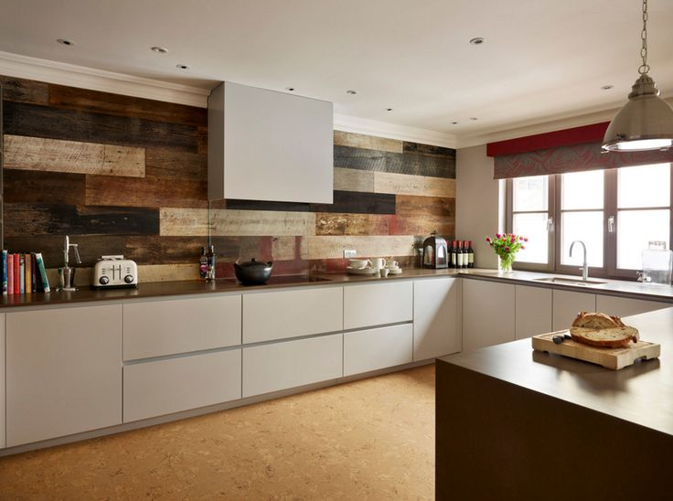 Stunning random timber planks are used as a feature wall in this contemporary kitchen with an industrial edge