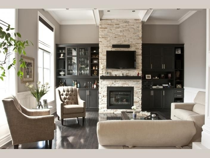 Neutral living room with a cosy fireplace and dramatic dark bookcases & floors.
