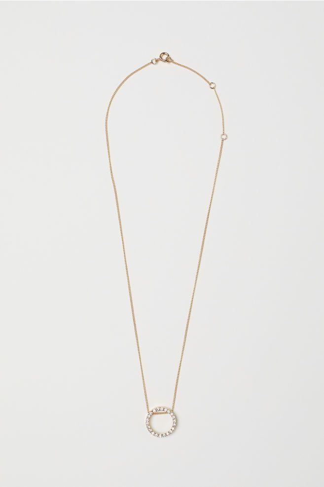 guldhalsband med hänge