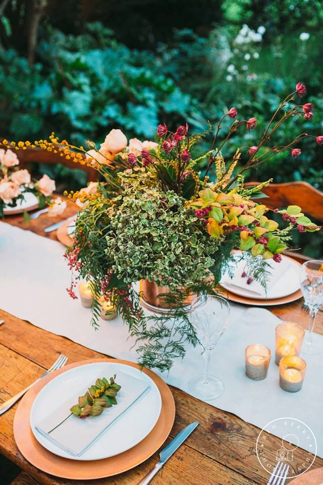 Wedding table flower arrangements by Shady Fig using peppercorn, julia roses, hydrangea and more. Shot by Red Berry Photography at Willow Farm Berry.