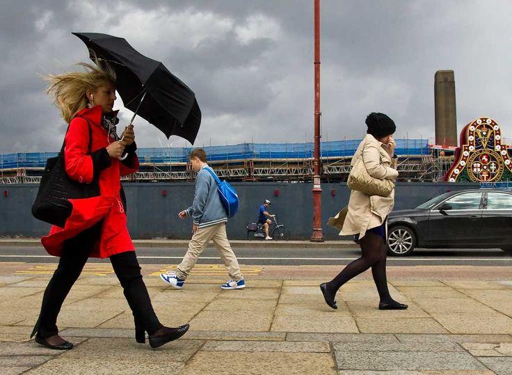 Street - people walking in the rain on Blackfriars Bridge in London