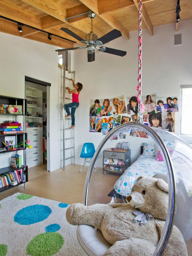 WEINSTEIN KIDS BEDROOM 2 - A hanging bubble chair provides the perfect place to curl up and read a book in this modern girl's room. When she's not plastering her wall with pictures of her favorite famous teens, she can usually be found up in her secret hideout. Accessed from a ship ladder mounted to the wall, this cozy space tucked above the closets even has lights and a small window. :)