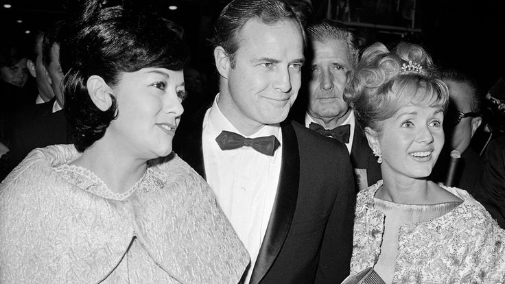 Marlon Brando with wife Movita Castaneda and Debbie Reynolds