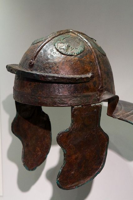 """Image 2: Imperial Italic """"G"""" helmet, discovered in Hebron, Israel and dated to the early II cent. CE, with reinforcement bands and appliques of half moons on crown. Probably a spoil of war taken by Jewish zealots during the Bar Kokhba Revolt (132-135 CE)."""