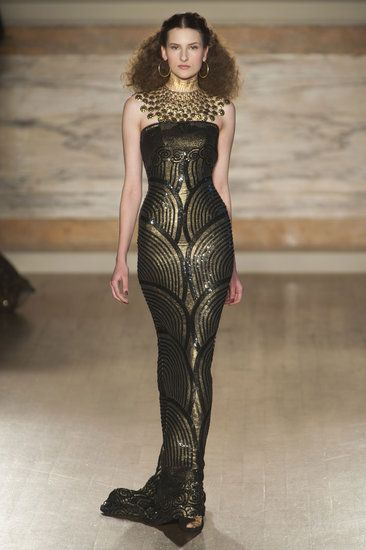 "L'Wren Scott's Fall 2013 London Fashion Week debut was filled with pure decadence, showcasing real gold — 23-carat gold, to be exact-Curve-hugging gowns featured their own ""built-in"" jewelry"