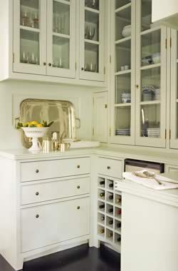 Butler's pantry w/glass front cabinets and wine rack. Tim Barber Architecture  Interior Design.