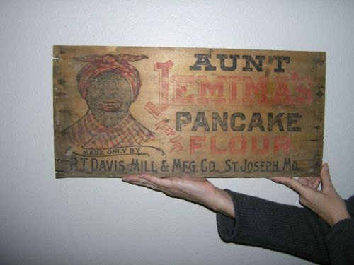 """Aunt Jemina's Pancake Flour Wooden Crate Box Panel R.T. Davis Mill MFG CO Wood...Antique Aunt Jemina Wooden Panel Hang this on the wall as it is or have it framed. This wood panel is from an old Aunt Jemina's Pancake Flour Mix Crate. The panel measures 22"""" long - 10 1/2"""" tall and 5/16"""" thick. The wood doesn't have any rot or mildew. The ends of the panel are splitting and there are old nail holes but this piece is very solid."""