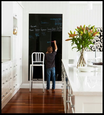 White kitchen , with Jarrah, and a chalkboard.