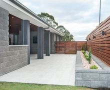 Concrete block planter with timber privacy screening. TV to covered outdoor entertaining area. Stone top to servery from outdoor kitchen.