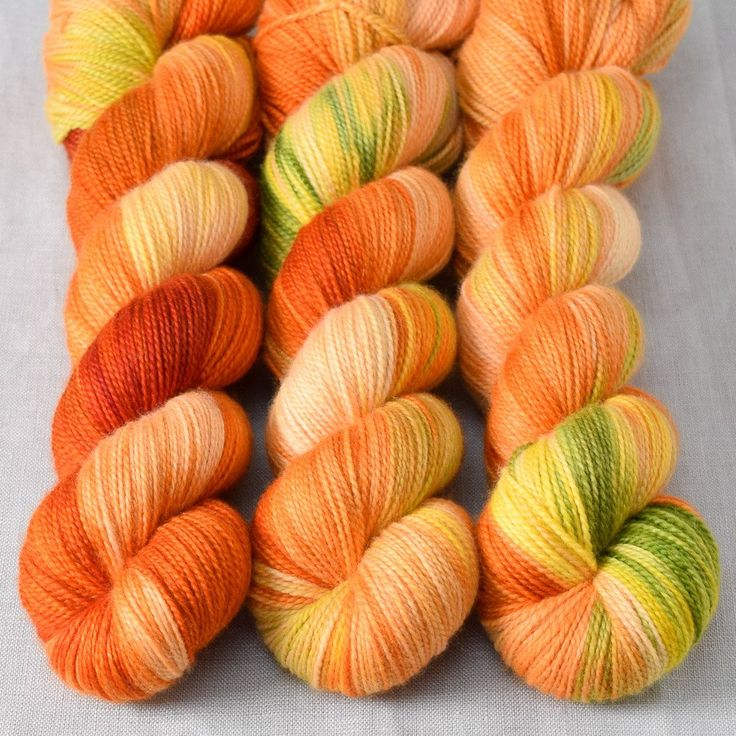 Nasturtium blossoms make a beautiful and spicy salad addition and also inspire this bold colorway. Shades of orange that range from creamy peach to deep marigold contrast with small splashes of neutra