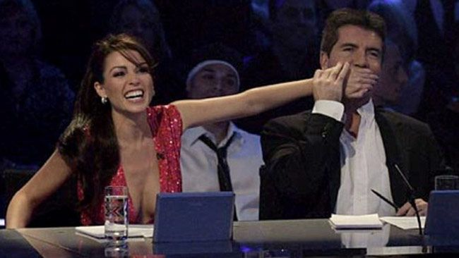 """SIMON Cowell admits he was for years in """"genuine love"""" with Dannii Minogue - even remodelling the panel of his UK show The X Factor to be closer to his co-star - claims a controversial new biography on the TV tycoon."""
