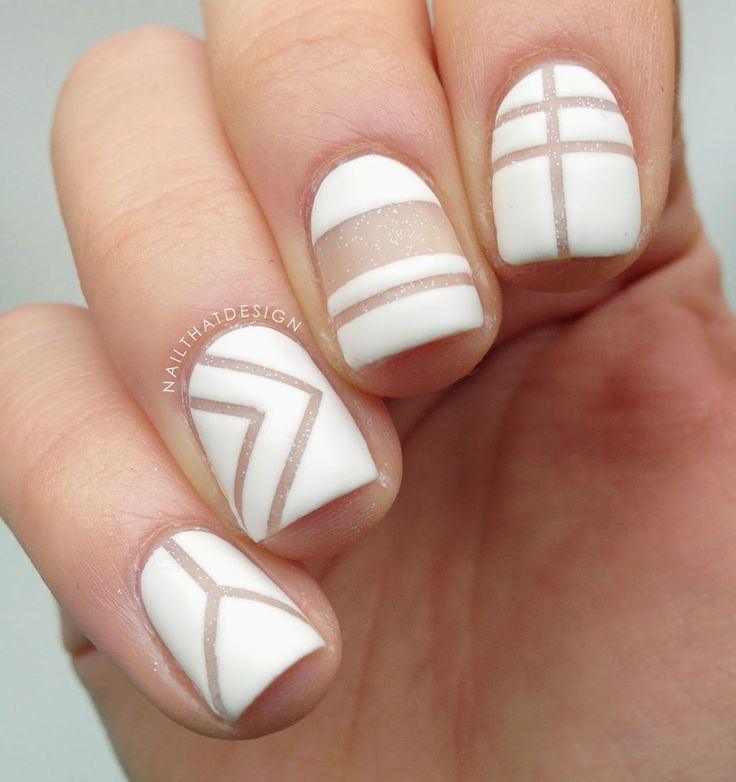 Less is more! We're all about the minimalist negative space nail art. Love the graphic white here.