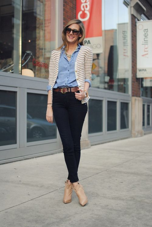 work outfit: blue button-up shirt, black skinny pants, nude ankle boots, leather belt, white and beige striped cardigan