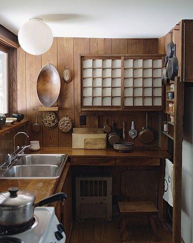 Nakashima kitchen; narrow shelving with towel rails evokes Ingleside Terrace kitchen