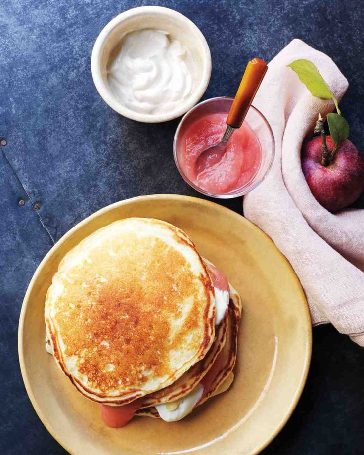 Applesauce Pancakes -- Get your morning off to a great start with this recipe for applesauce pancakes. With applesauce added to the batter and layered in between pancakes along with sour cream, these are sure to become a favorite in your home.