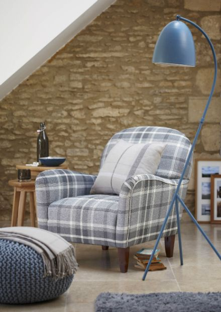 Lausanne Armchair Check, Charcoal,£299. Stockholm Nest of 2 Occasional Tables, £129. Devon Floor Lamp, Blue, £69. Soft Shaggy Rug, Grey, £20. Tartan Cushion, Grey, £10. Tesco Direct