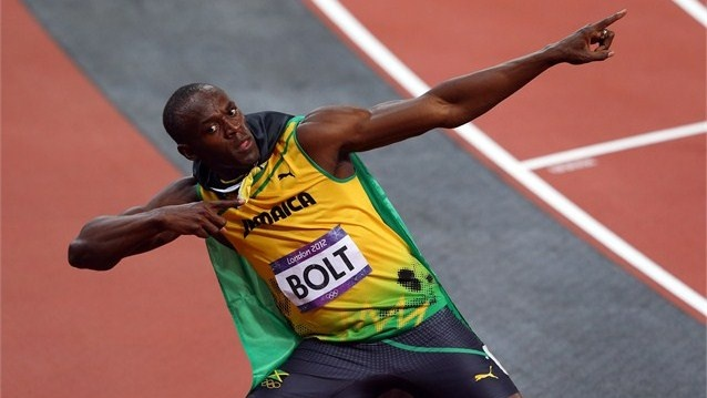 Usain Bolt celebrates his win in the 100m men's sprint final. He set a new Olympic record time of 9.63 to claim the gold ahead of Yohan Blake 9.75 and 2004 Olympic champion Justin Gatlin 9.79 - London 2012 Olympics