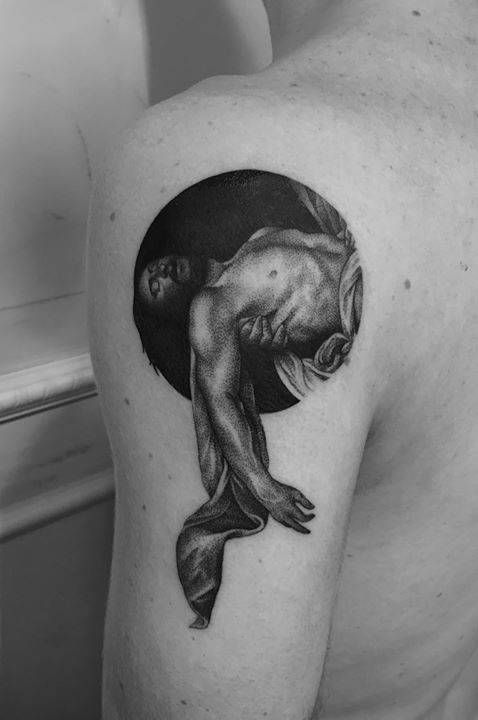 Caravaggio's The Entombment of Christ inspired tattoo on the back of the left arm.