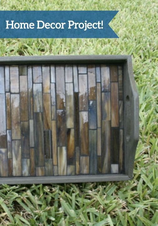 This DIY Glass Tiled Serving Tray will be a gorgeous addition to your home decor. This piece adds an elegant look to any room, but it's half the price of the retail version!