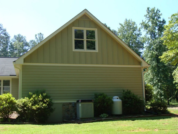 Board batten above lap siding carriage house for Pictures of houses with board and batten siding