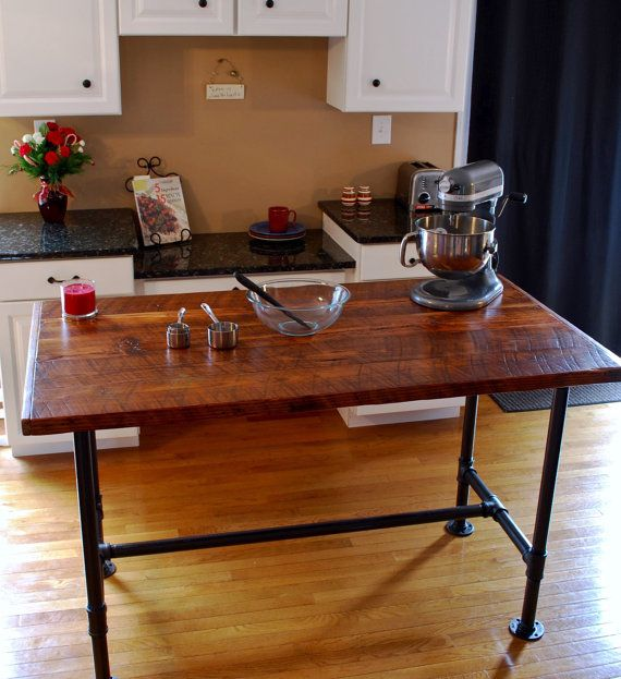 Make this reclaimed wood table the centerpiece of your kitchen! Use this industrial work table as a kitchen island, dining room table, or
