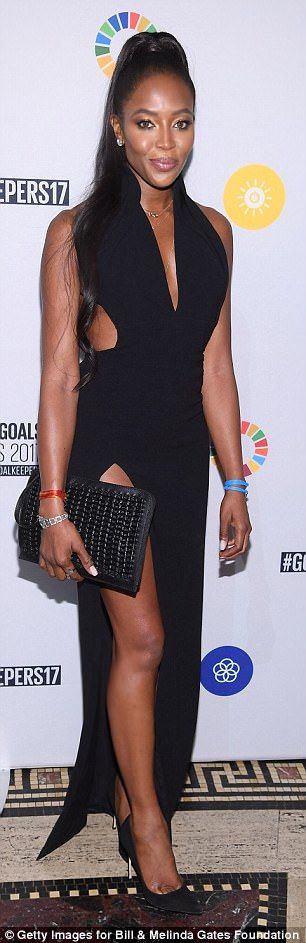 Stunning: Naomi Campbell looked incredible in the black gown that featured a thigh-high sl...