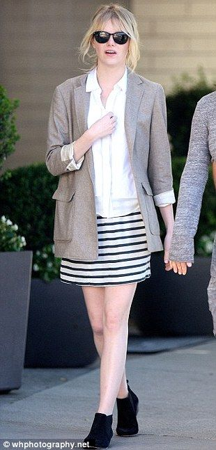 Earning her stripes: Emma looked casual and chic in a striped skirt and grey blazer