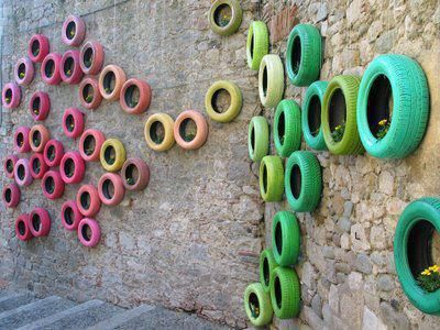 recycled tires, painted and hung on wall. could fill with flowering plants.  lOVE IT:))))