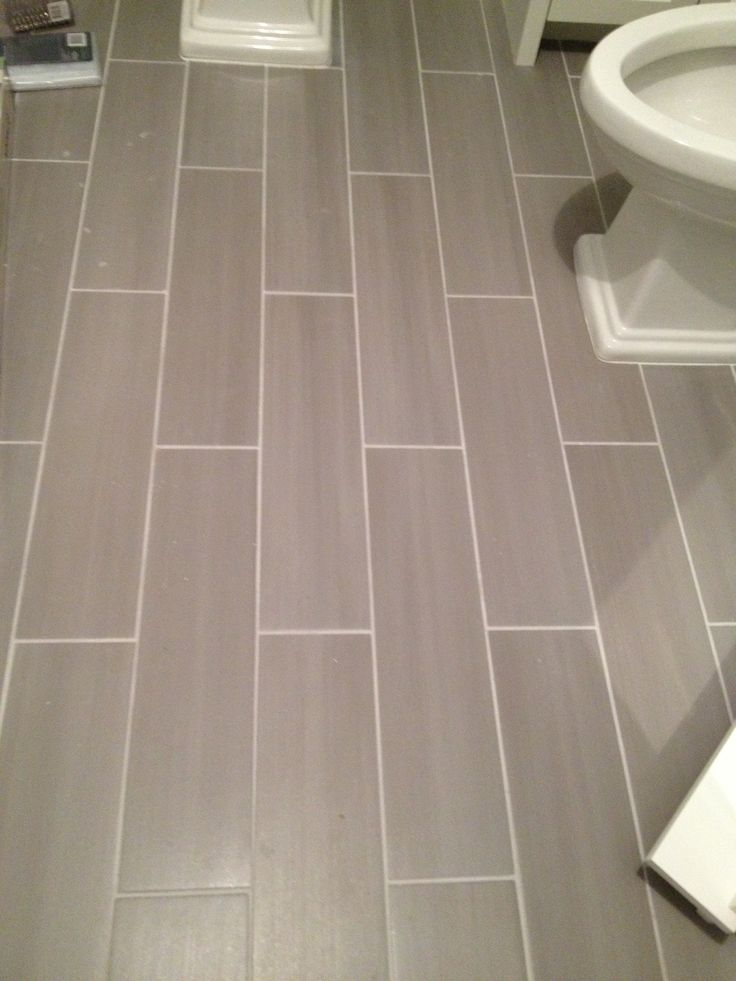 Guest bath plank style floor tiles in gray sarah for Grey wood floor bathroom