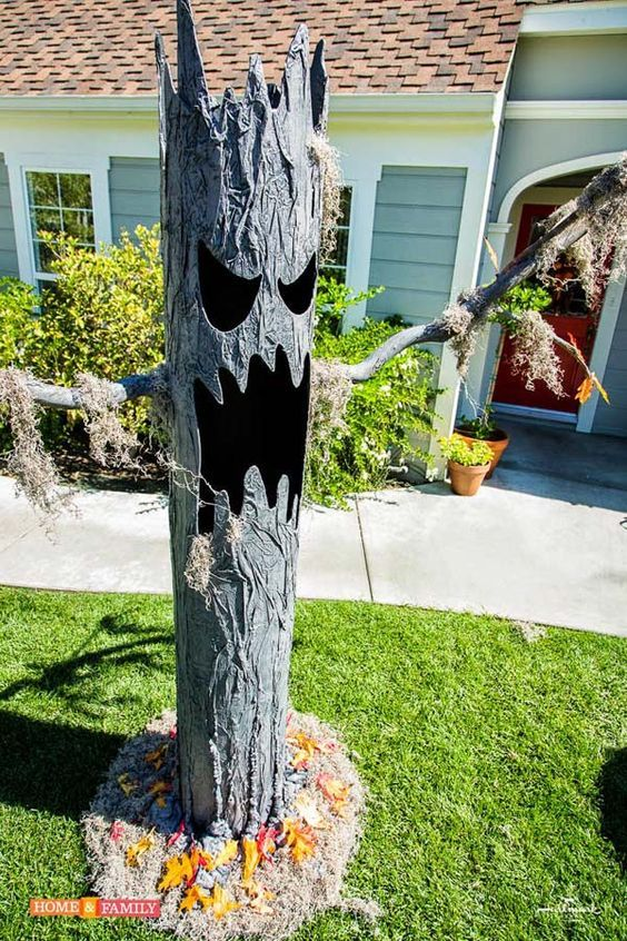 Make use of concrete tube and some other materails to create a lawn spooky tree: