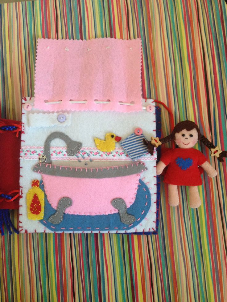 Felt Quiet Book Bathroom (Take a Shower) Page with Felt Doll. It is possible to open and fix the shower curtain and insert the felt doll into the bathtub. This is one of the pages I made for Mila's quiet book. This one is my favorite :)