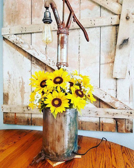 Farmhouse Table Lamp / Water Pump / Seeder Bucket / Primitive Lighting / Rustic / Edison Lamp / Yellow Sunflower Light / Vintage Lighting https://www.etsy.com/listing/581727619/farmhouse-table-lamp-water-pump-seeder