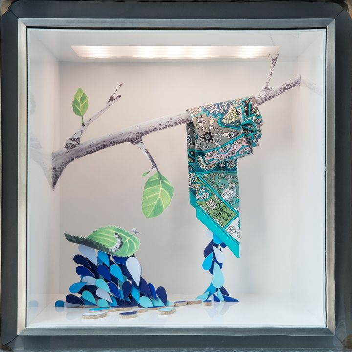 In the large front window, Daëron depicts various stages of water, and the characteristics it can take on in the natural world.