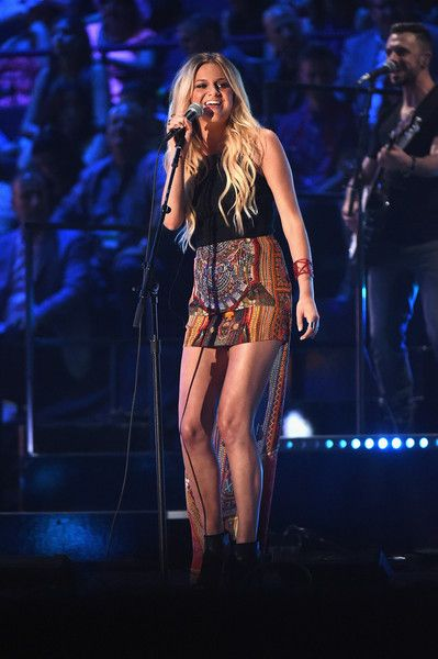 Kelsea Ballerini Photos Photos - Singer Kelsea Ballerini performs onstage during the 2015 CMT Music awards at the Bridgestone Arena on June 10, 2015 in Nashville, Tennessee. - 2015 CMT Music Awards - Show