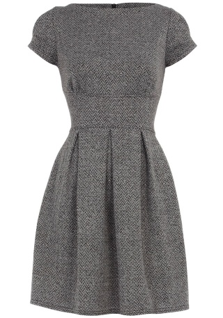 Winter wear tweed dress with black stockings and boots