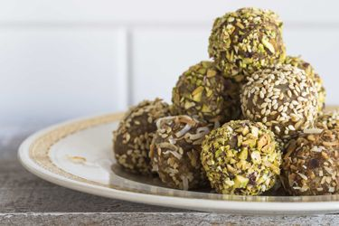 Orange, date, coconut, seed and honey balls