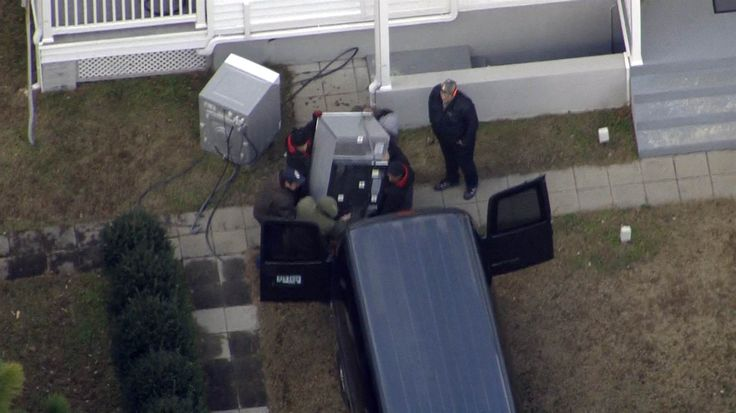 Image: Equipment is removed from the Russian compound at Pioneer Point in Maryland.