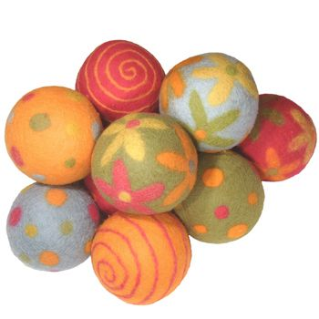 """Felted balls of boiled wool and natural dyes, available in several palyful color combinations and designs.  5"""" in diameter"""