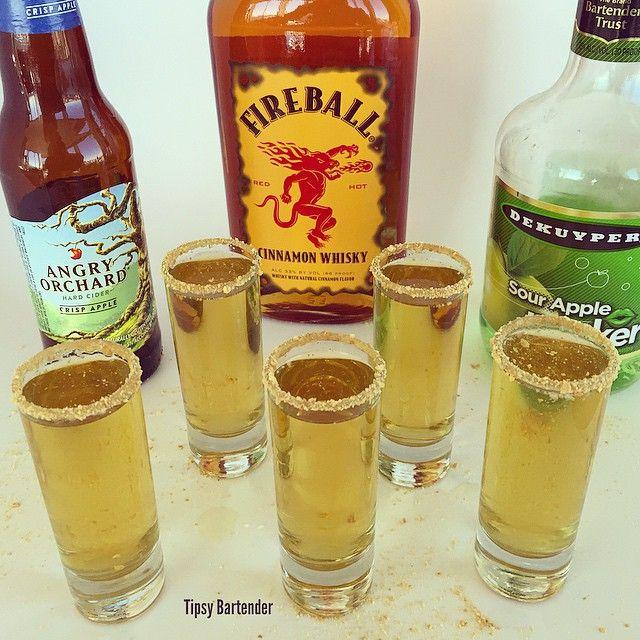 THE APPLE SAUCE SHOT ~ 1/2 oz. (15ml) Fireball Whisky, 1/2 oz. (15ml) Apple Pucker, 1/2 oz. (15ml) Pineapple Juice, 1/2 oz. (15ml) Apple Cider, Caramel Syrup, Graham Cracker