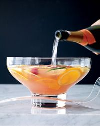 Thanksgiving Cocktail Party Punch -  In a large punch bowl, combine the fruit, gin, lemon juice, simple syrup, orgeat syrup and framboise liqueur. Refrigerate for 4 to 5 hours. Just before serving, stir in the chilled Prosecco and add a supersize ice block.