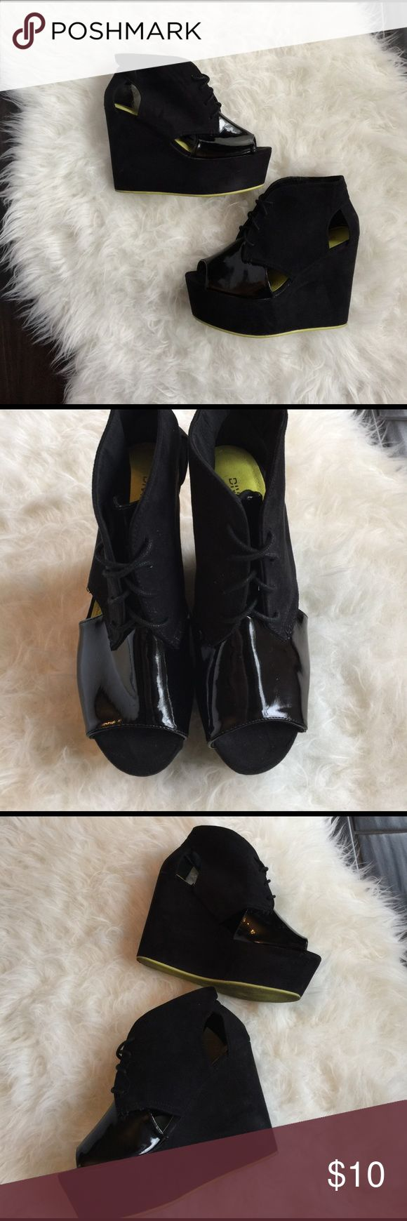 Black platform wedge shoes.  Black wedge shoes Good used condition black wedge shoes from H&M. These shoes are very lightweight and easy to wear. Tiny stripe of lime green on the sole. Approximately 4 1/4 heel height at the tallest point and approximately 2 inches at lowest. Please review photos for details and where, no lowball offers or trades. Reasonable offers considered. Divided Shoes Wedges